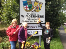 FairTrade Group members cleaning Gateway signs